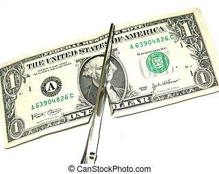 cutting costs - dollar bill being cut