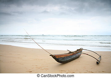 Outrigger under a stormy sky - A fisherman's outrigger under...