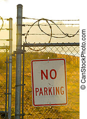 No Parking - Photo of a No Parking sign with barbed wire