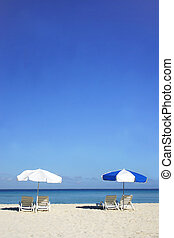 Beach Umbrella Series - Two sun umbrellas on tropical beach