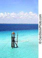 Blue Sea Tower - Tower in the blue sea off Isla Mujeres,...