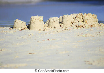 Sandcastle on white sand beach