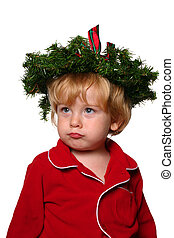 Bah Humbug - young pouting boy with a wreath of pine boughs...
