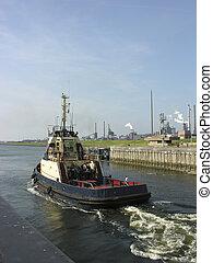 tug boat - tugboat in the locks of Ijmuiden