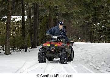ATV quad senior rider - Senior male riding a four wheel ATV...
