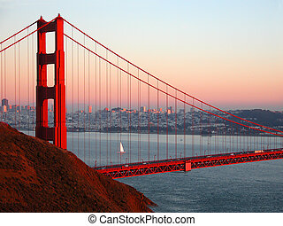 Golden Gate Sailing - A lone sailboat sailing near the...