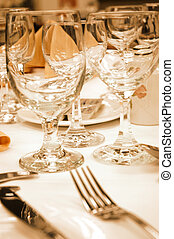 Wine glasses in warm lighting - Ready for a formal dinner of...