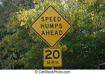 Speed Humps - Speed humps sign with trees