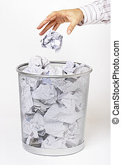 Hit or miss - Hand throwing rubbish in waste paper basket