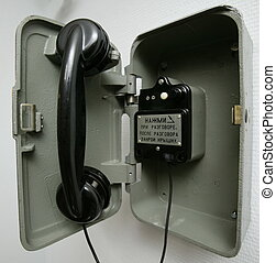 One button phone - phone on the wall. Russian text on the...
