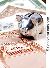 Market - Photo of Stock Certificates and a Piggy Bank