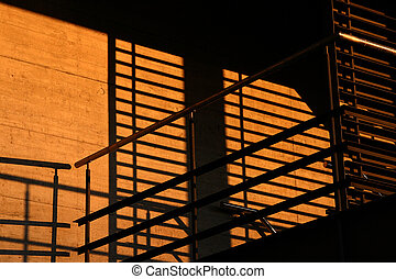 Shadows in the sunset - Shadows on concreet of a metallic,...