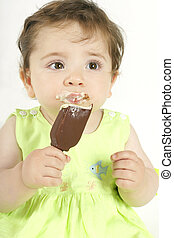 Baby Girl with Ice Cream - Baby girl eating a choc coated...