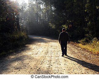thoughtful walk - thoughtful, contemplative man walking up...