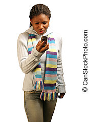 Angry W/ Clipping Path - A teenage girl looking at her phone...