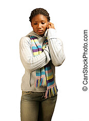 On Hold W/ Clipping Path - A teenage girl on a cell phone...