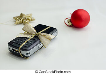 cell phone and christmas balls on white background