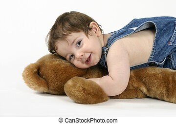 My Best Friend - A beautiful baby cuddles a teddy bear