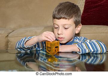 Dreidel - Young Boy Playing with a Dreidel