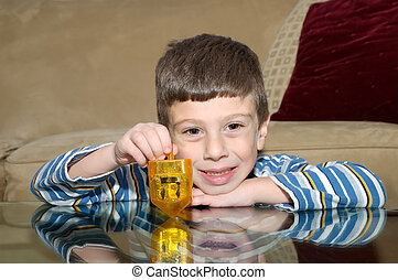 Dreidel - Young Boy Playing with a Dreidel
