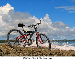 Mountain-bike on beach - Mountain-bike in front of tropical...