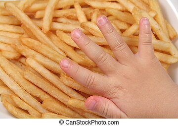 french fries and child hand
