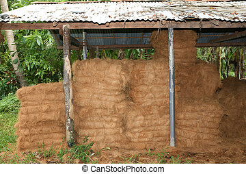 Copra store - Bales of copra coconut fibre stored at a...