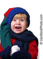 Snow - toddler in winter hat and mittens holding a snowball