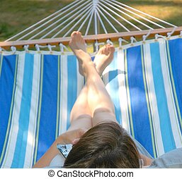 Female in Hammock - Female relaxing in hammock