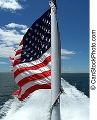 American flag on the back of a boat