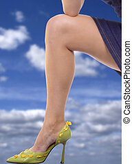 Legs Forever! - Gorgeous leg in spiked shoe with clouds in...