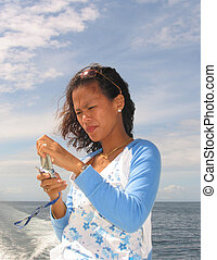Asian woman on the p - Maricel on the phone, Philippines