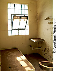 Prison Cell - Abandoned military prison cell with toilet and...