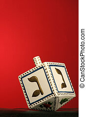 chanukkah dreidel - clay chanukkah dreidel on red background