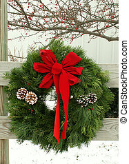 outdoor wreath - wreath hanging on a wooden fence