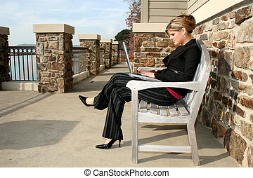 Beautiful Young Woman at the Lake with Laptop - Young woman...