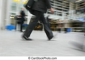 Walking Businessman - stressed motion, blurry image,...