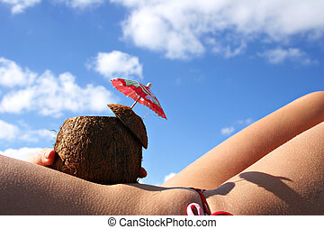 Coconut Drink babe - Sunbathing woman with coconut cocktail