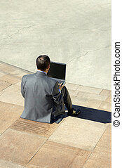 businessman working on the laptop - working outside