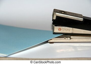 Stapler with Sheets - A stapler with some sheets to staple