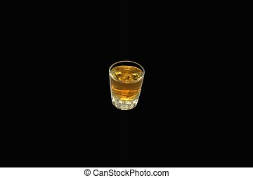 A Shot in The dark - a shot glass of whiskey