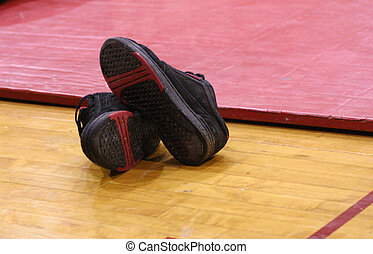 Wrestling Shoes - Wrestling shoes sitting by mat