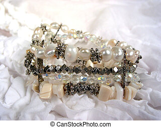 Pearl bracelet on white frilly womens shirt