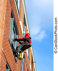 Window washer working on a building wall