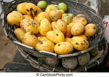 Tropical fruits - Sri Lankan mangoes in a basket, on top of...