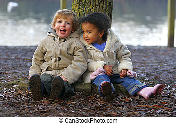 Resting Together - A little blond boy and a mixed race girl...