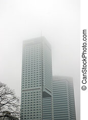 Scyscrapers in the mist - Two scyscrapers in fog.