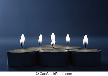 Candles on blue - Six candles burning on blue background.