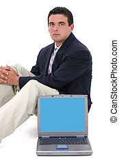 Business Man Laptop - Attractive young business man in suit,...