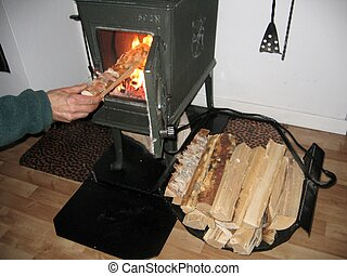 Making a fire - someone making a fire in a stove